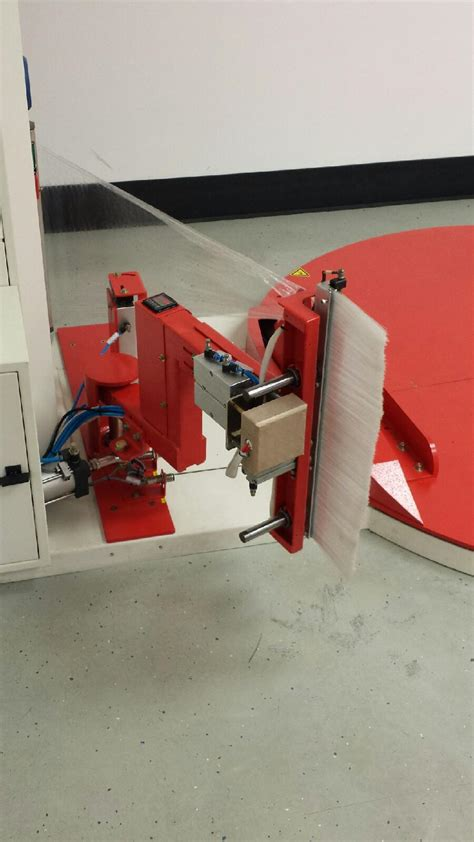 automatic stretch wrapper to keep drivers on forklifts