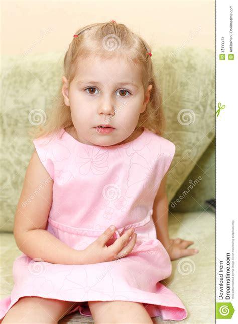 little girls sofa little girl on sofa stock photography image 21998572