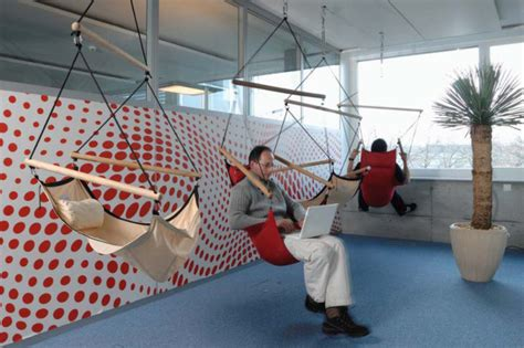 google z rich office slide to the canteen youtube 8 of google s craziest offices co design