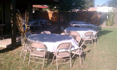 backyard party setup table and chair rentals for a house warming party