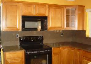 Old fashioned kitchen paint colors with maple cabinets and black stove