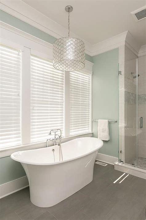 light over bathtub bathroom with wood like tiles design ideas