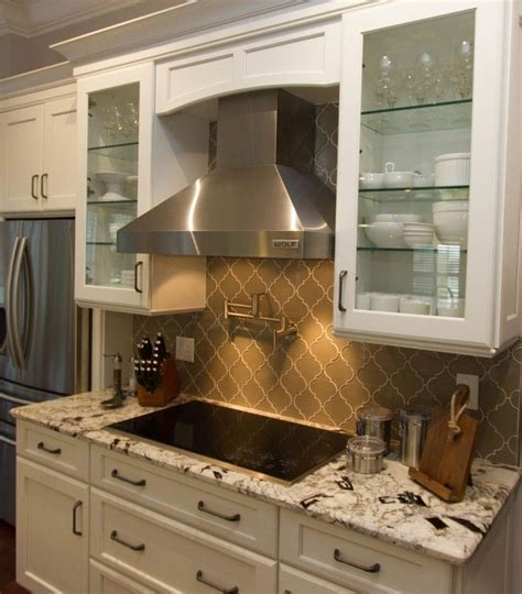 exotic kitchen cabinets love this look grey arabasque tile with white cabinets