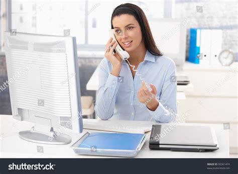 attractive sitting desk work on stock photo 93361474