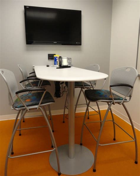 huddle room kimball table with sit on it stools lobby