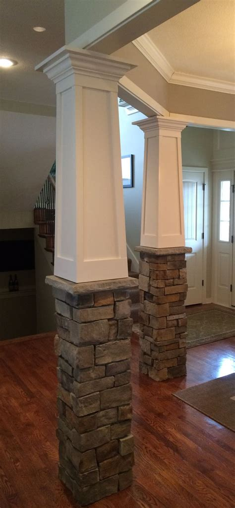 interior pillars tapered craftsman columns with stone base built over