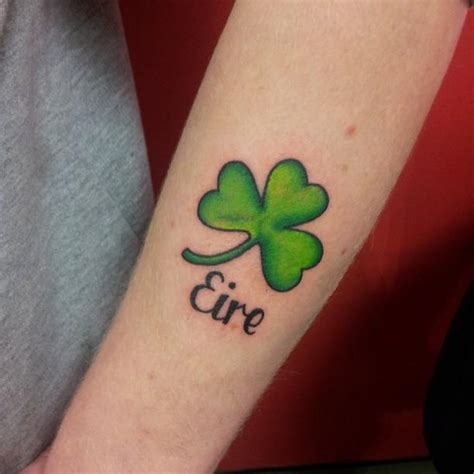 eire tattoo designs lovely shamrock leaf with eire word on arm sleeve