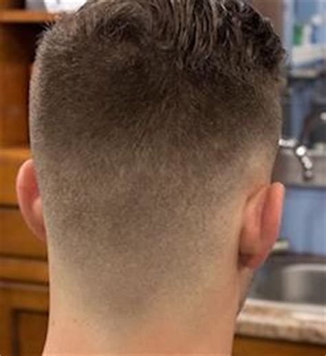 women haircut tapered neck behind ear fade haircut guide 5 types of fade cuts curly