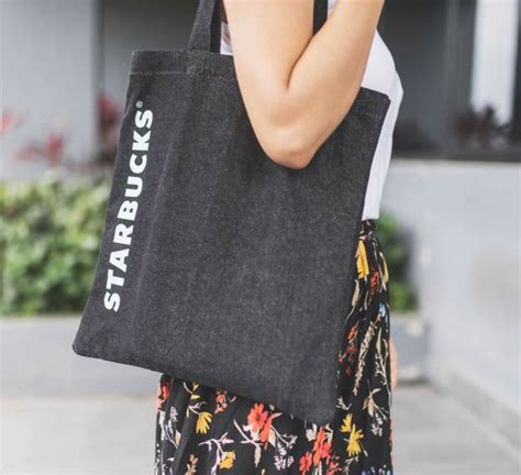 this starbucks black denim tote bag is yours with every 25 spent at their stores great deals