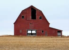 sk11j04 red hip roof barn in rm harris saskatchewan