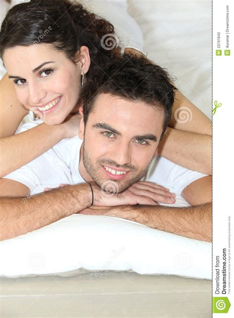 young couple laying in bed stock photos image 23791843