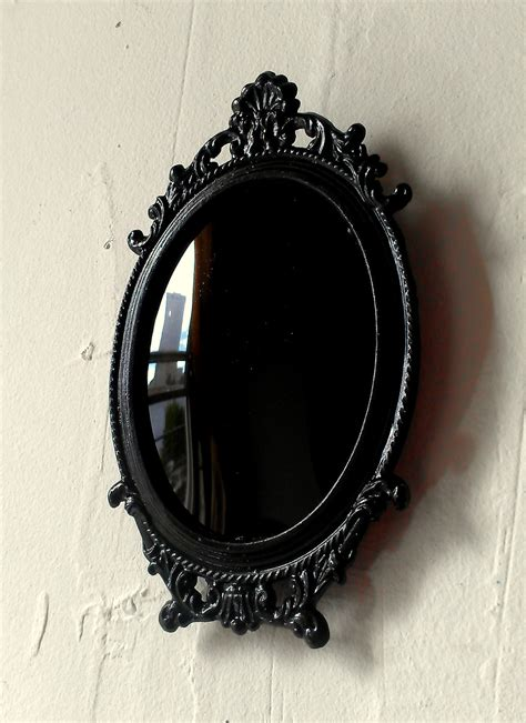 black mirror black scrying mirror in miniature vintage oval frame with
