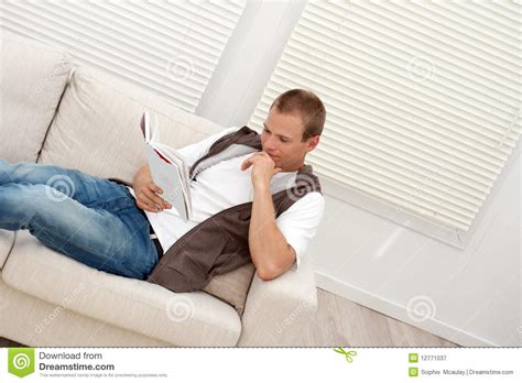 relaxing on the couch man relaxing on the couch royalty free stock photography