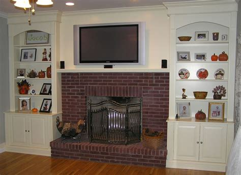 fireplace with bookshelves on each side fireplace