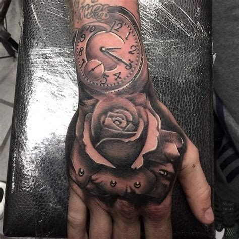 hand tattoo rose clock rose clock hand tattoo pictures to pin on pinterest