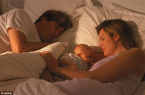 sleeping with baby in bed co sleeping the new parenting fad experts fear could kill