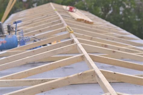can i convert my flat roof to a pitched roof modernize