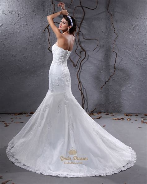 ivory strapless mermaid appliques wedding dress with