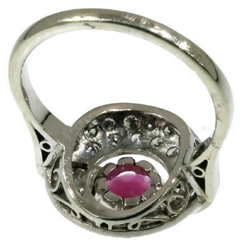 Ruby 3 5 Crt white gold deco ring with 0 90 crt and ruby 0