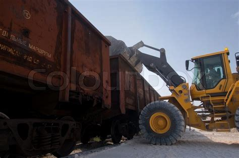 Truck Load Of Gravel Cost Excavator Loads Gravel Stock Photo Colourbox