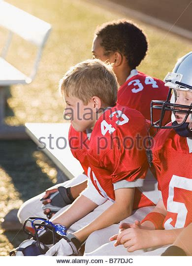 football player on bench football bench stock photos football bench stock images alamy