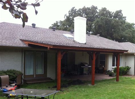 Patio Covers Dallas Tx by Clean Shingled Patio Cover Extends Patio And Yard