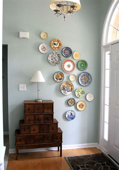 hang pictures on wall how to hang plates on a wall to create an eye catching look