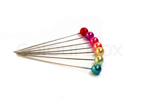 seven colorful sewing pins on a white background stock