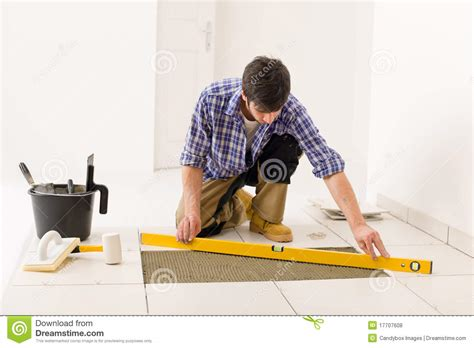 home tile improvement handyman with level royalty free