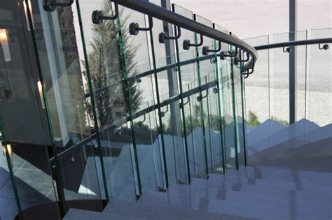 Granite Treads with Curved Railings and Glass Panels Modern Staircase edmonton by