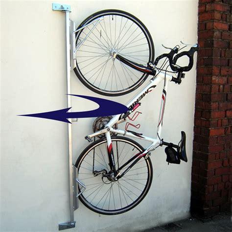 bike wall hanger wall mounted pivotting bike hanger parrs workplace equipment