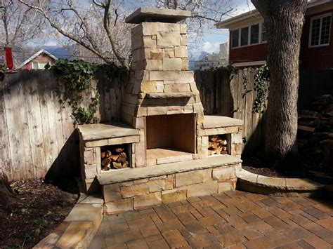 outdoor fireplace with dual wood boxes