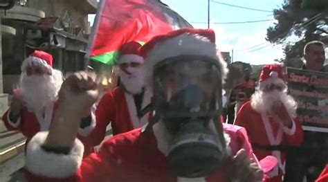 santa claus usa army bethlehem palestinian protesters dressed as santa claus clash with israeli army in west bank