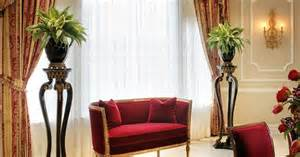 formal dining room decor featuring paneled wall and adam