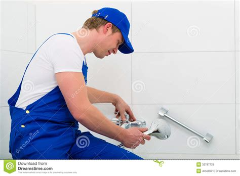Shower Not Working by Plumber Repairing Shower In Bath Room Stock Photos Image
