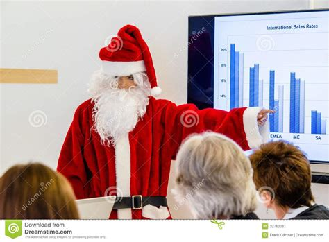 Executive House Plans female santa claus presenting in business meeting stock