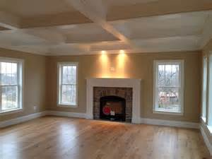 coffered ceiling and custom wood mantle fireplace