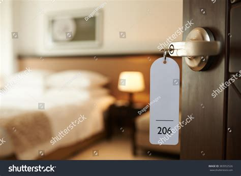 Hotel Room Key by Opened Door Hotel Room Key Lock Stock Photo 383952526