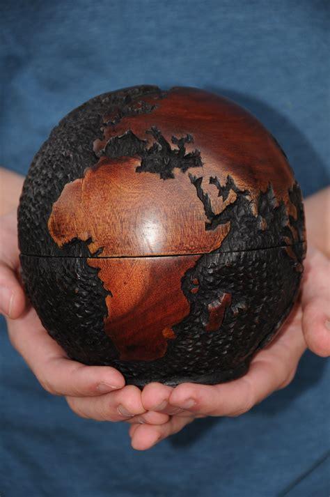 Kaos Globe 111 Original rosewood carved globe on storenvy