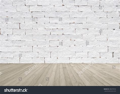 white painted brick wall texture with wooden floor in light sepia grey brown color tone for