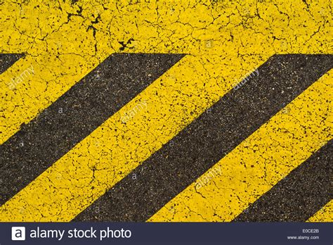 pattern of yellow lines on the roadway yellow striped road markings on black asphalt highway no