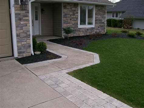 widening the driveway and walkway with paver stones instead of redoing the whole driveway we
