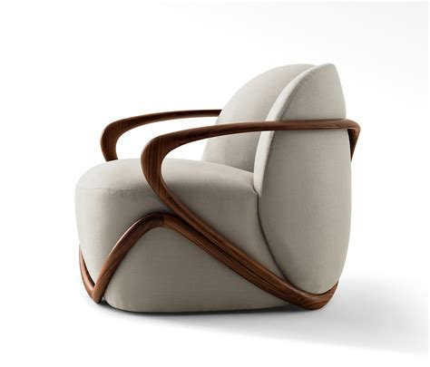 armchair buy hug armchair lounge chairs from giorgetti architonic