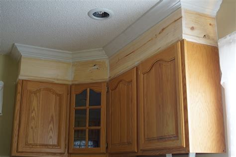 how do you install crown molding on cabinets diy kitchen cabinet upgrade with paint and crown molding