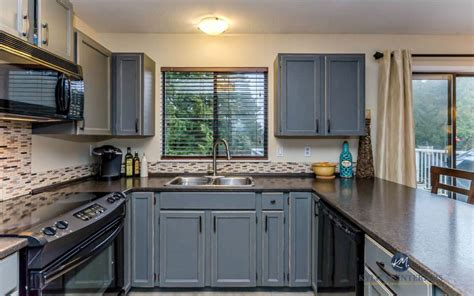 kitchen painted  distressed cabinets oak  gray