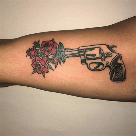 gun with rose tattoo best 25 gun tattoos ideas on pistol gun