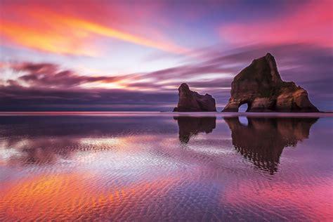 sunset reflection    zealand beach hd wallpaper