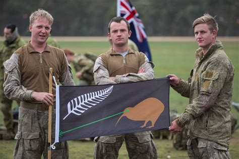 tattoo camo nz new zealand army soldiers holding up the laser kiwi flag