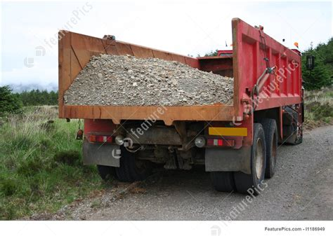 photograph of truck with gravel load