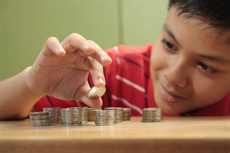 Teaching kids about money will help them avoid debt issues